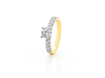 Four Claw Set side Diamond Engagement Ring